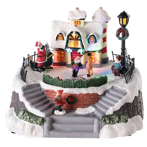 Casa di Babbo Natale con elfi per villaggio 15x20 cm 1