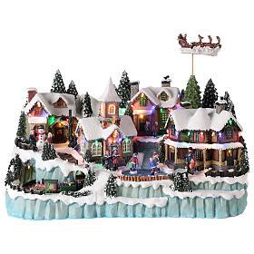 Village avec traîneau de Père Noël en mouvement 40x55x30 cm s1