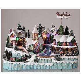 Village avec traîneau de Père Noël en mouvement 40x55x30 cm s2