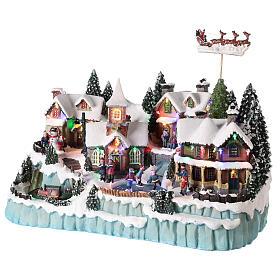 Village avec traîneau de Père Noël en mouvement 40x55x30 cm s3