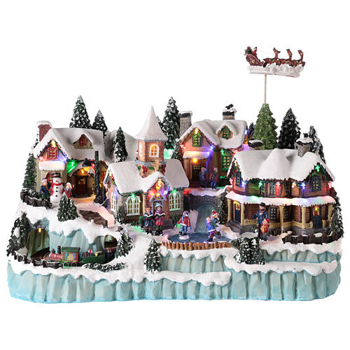 Village avec traîneau de Père Noël en mouvement 40x55x30 cm 1