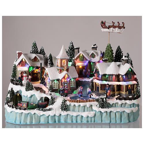 Village avec traîneau de Père Noël en mouvement 40x55x30 cm 2