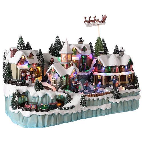 Village avec traîneau de Père Noël en mouvement 40x55x30 cm 4