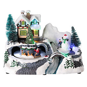 Village with Santa Claus on a moving sled 20x25x15 cm s1