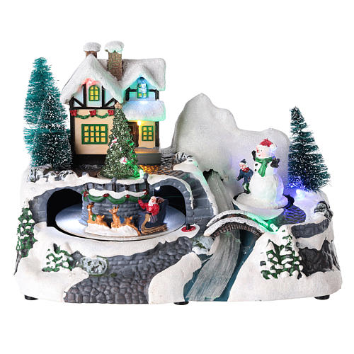 Village with Santa Claus on a moving sled 20x25x15 cm 1