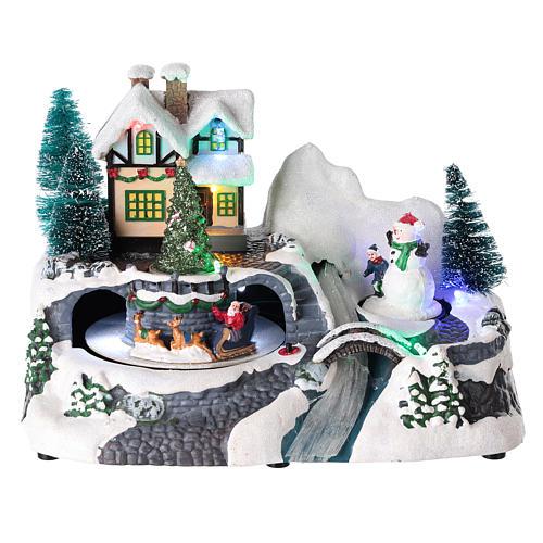 Village avec Père Noël sur traîneau en mouvement 20x25x15 cm 1