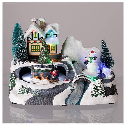 Village avec Père Noël sur traîneau en mouvement 20x25x15 cm 2
