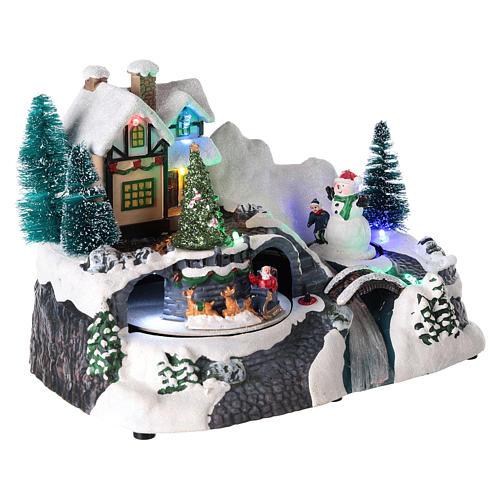 Village avec Père Noël sur traîneau en mouvement 20x25x15 cm 4