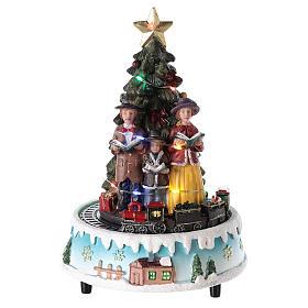 Villages de Noël miniatures: Sapin de Noël avec choeur 15x20 cm