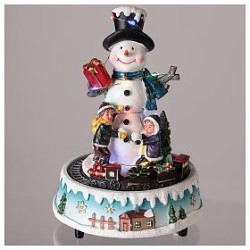 Pupazzo di neve con doni 15x20 cm s2