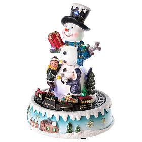 Pupazzo di neve con doni 15x20 cm s3