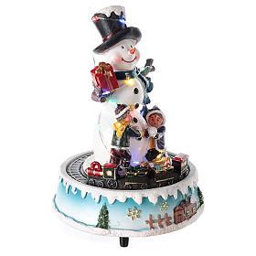 Pupazzo di neve con doni 15x20 cm s4