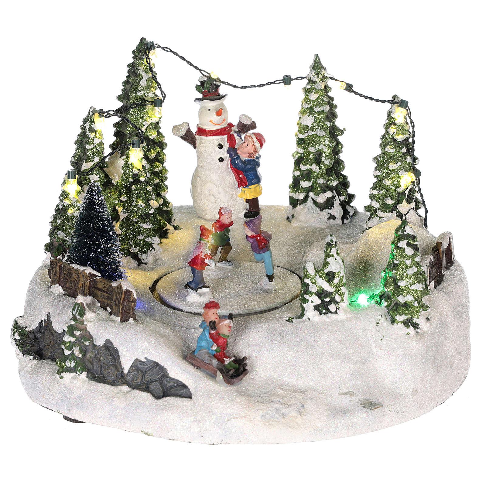 Scène pour village Noël piste de patinage et bonhomme de neige 15x20 cm 3