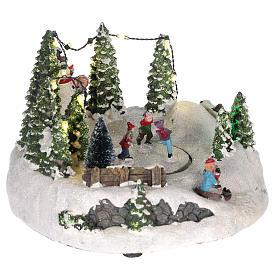 Scène pour village Noël piste de patinage et bonhomme de neige 15x20 cm s4