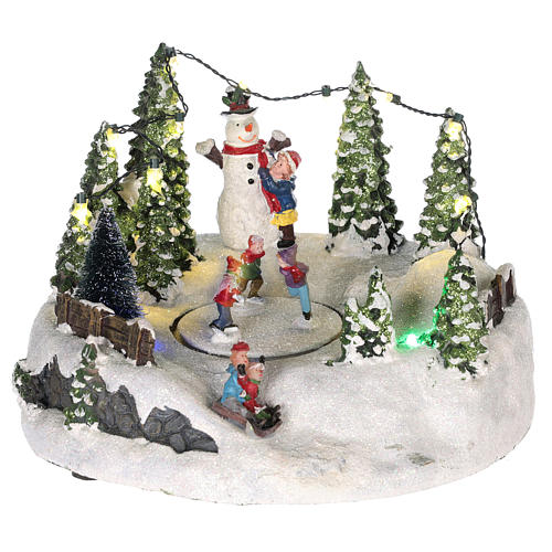 Scène pour village Noël piste de patinage et bonhomme de neige 15x20 cm 1