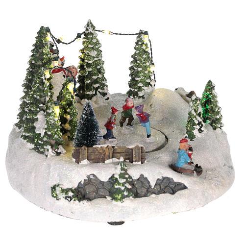 Scène pour village Noël piste de patinage et bonhomme de neige 15x20 cm 4