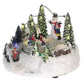 Scene for Christmas village: ice rink and snowman 15x20 cm s3