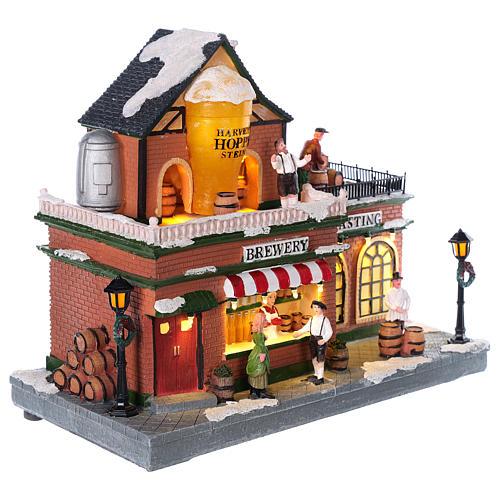Fábrica de cerveza en tema navideño con luces y movimiento 30x35x30 4