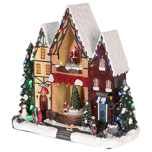 Christmas house in resin with light, music and movement 35x35x15 cm 3