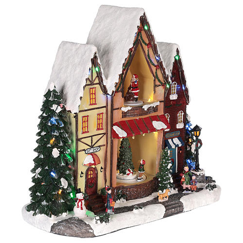 Christmas house in resin with light, music and movement 35x35x15 cm 4