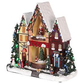 Maison de Noël avec mouvements lumières et musique 35x35x15 cm s3