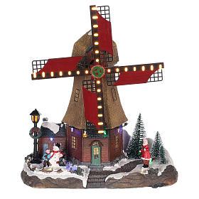 Casa di Natale con movimenti luci e musica 35x35x15 cm s1