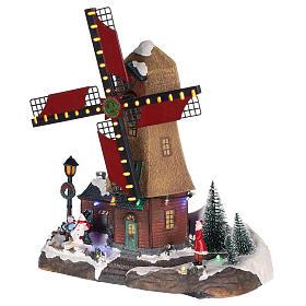 Casa di Natale con movimenti luci e musica 35x35x15 cm s3