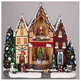 Casa di Natale con movimenti luci e musica 35x35x15 cm s8