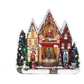 Casa di Natale con movimenti luci e musica 35x35x15 cm s12