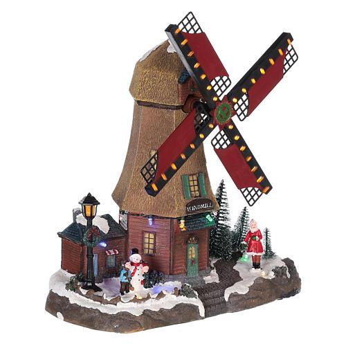 Casa di Natale con movimenti luci e musica 35x35x15 cm 4