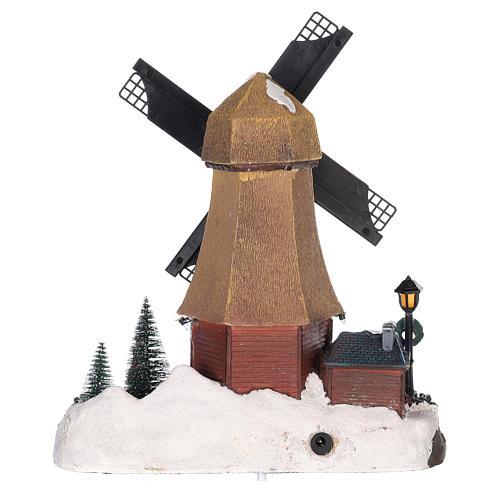 Casa di Natale con movimenti luci e musica 35x35x15 cm 5