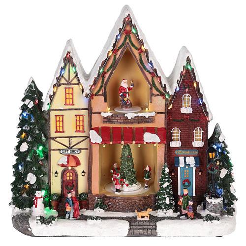 Casa di Natale con movimenti luci e musica 35x35x15 cm 7