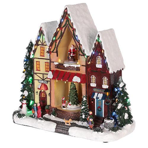 Casa di Natale con movimenti luci e musica 35x35x15 cm 9