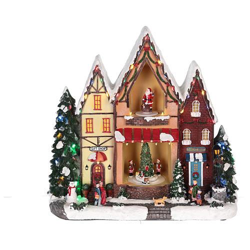 Casa di Natale con movimenti luci e musica 35x35x15 cm 12