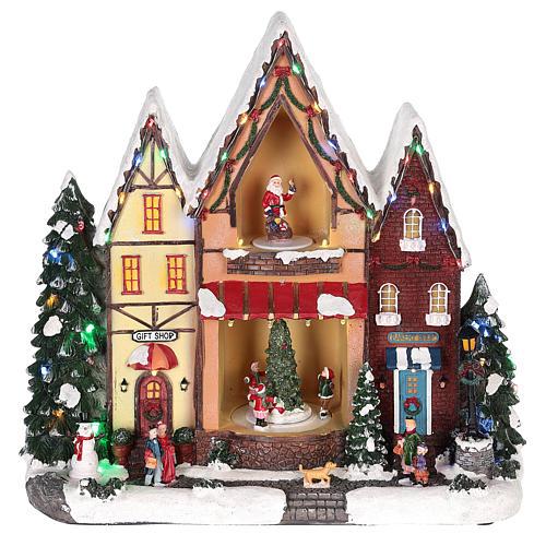Casa di Natale con movimenti luci e musica 35x35x15 cm 1