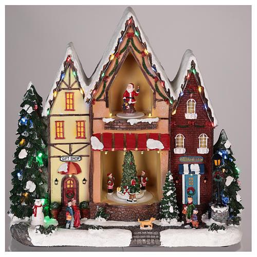 Casa di Natale con movimenti luci e musica 35x35x15 cm 2