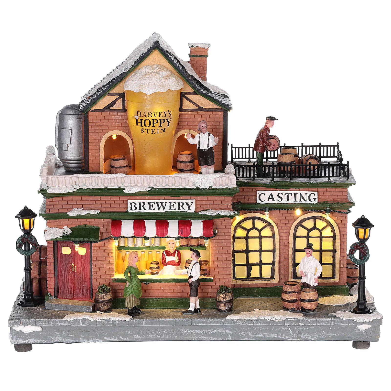 Casa de Navidad con tiovivo y Papá Noel 45x25x20 cm 3