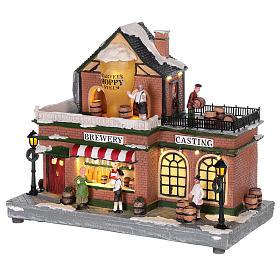 Casa de Navidad con tiovivo y Papá Noel 45x25x20 cm s3