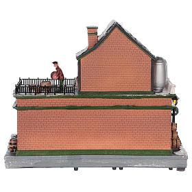 Casa de Navidad con tiovivo y Papá Noel 45x25x20 cm s5