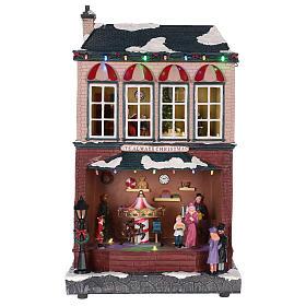 Casa de Navidad con tiovivo y Papá Noel 45x25x20 cm s7
