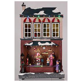 Casa de Navidad con tiovivo y Papá Noel 45x25x20 cm s8