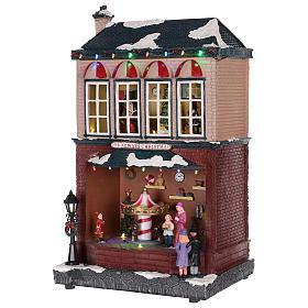 Casa de Navidad con tiovivo y Papá Noel 45x25x20 cm s9