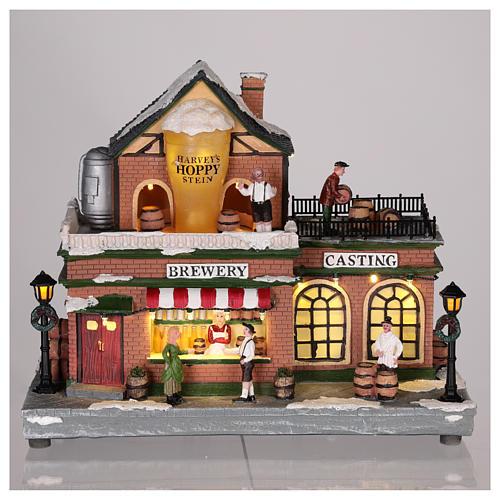 Casa de Navidad con tiovivo y Papá Noel 45x25x20 cm 2