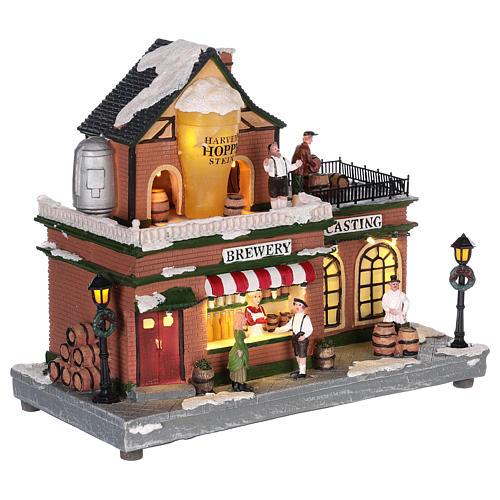 Casa de Navidad con tiovivo y Papá Noel 45x25x20 cm 4