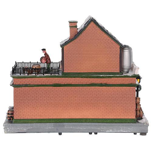 Casa de Navidad con tiovivo y Papá Noel 45x25x20 cm 5