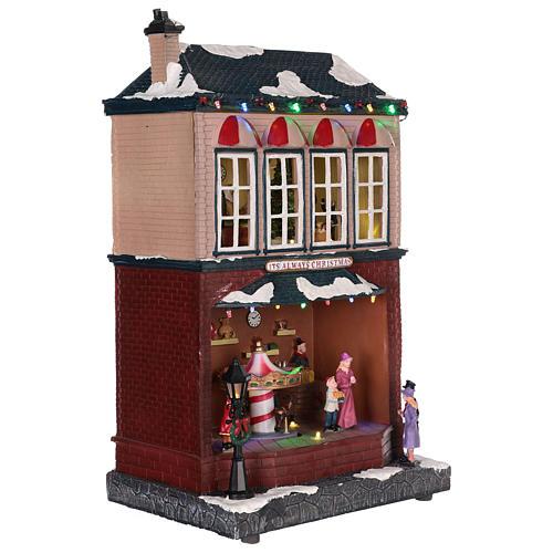 Casa de Navidad con tiovivo y Papá Noel 45x25x20 cm 10