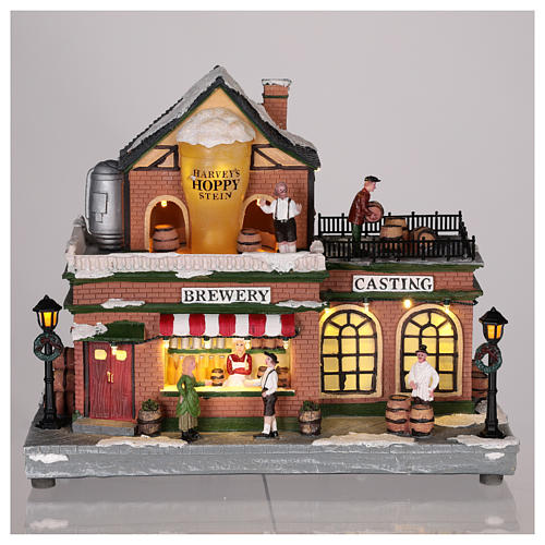 Casa di Natale con giostrina e Babbo Natale 45x25x20 cm 2