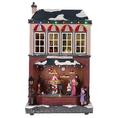 Casa di Natale con giostrina e Babbo Natale 45x25x20 cm 7