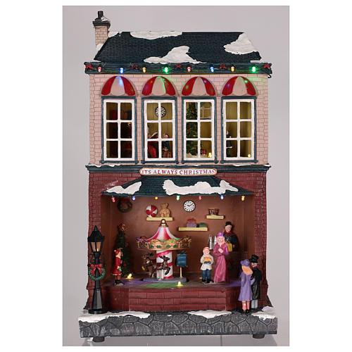 Casa di Natale con giostrina e Babbo Natale 45x25x20 cm 8