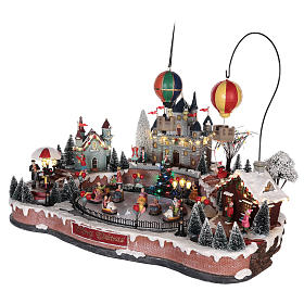 Christmas village with hot air balloons and track for cars 30x65x40 cm s3